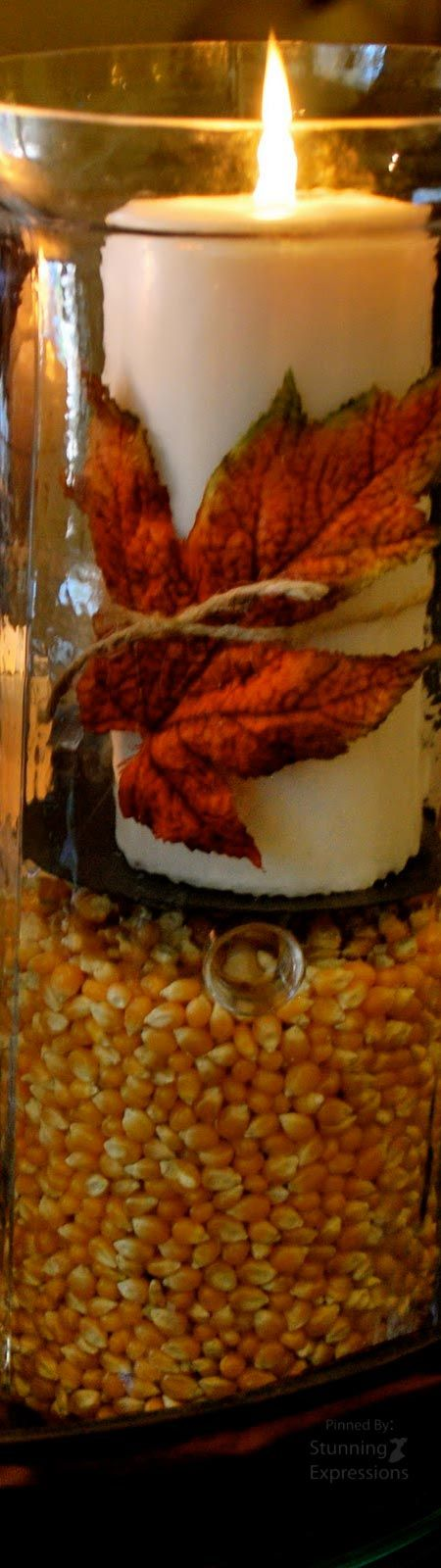 candle wrapped with a fall leaf 373