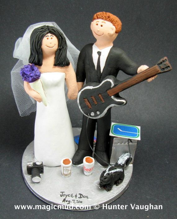 Rock Guitarist's Wedding Cake Topper, Guitar Wedding Cake Topper, Photographer Bride Wedding Cake Topper, Rock n Roll Bride and Groom CakeTopper  The photographs in this listing are but an example of what we will create for you....simply email or call toll free with your own info and pictures of yourselves, and we will sculpt for you a treasured memory from your wedding!    $235 #magicmud 1 800 231 9814 www.magicmud.com