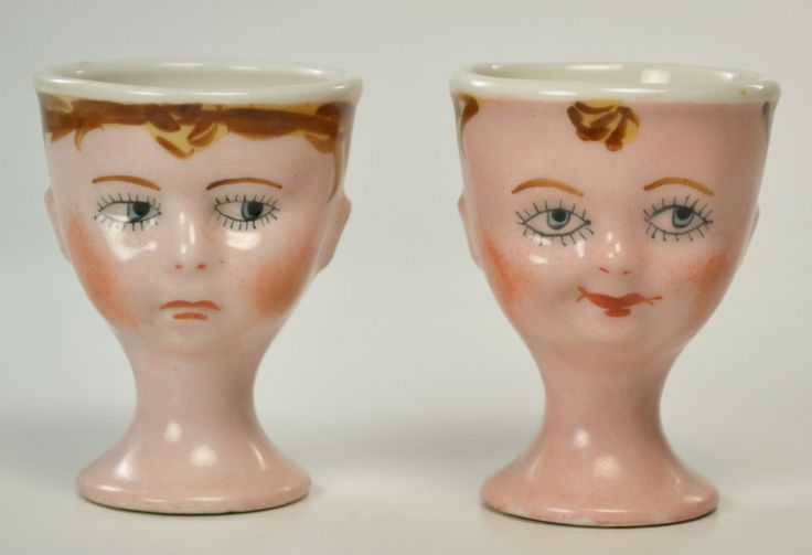 Limoges egg cups - sad / happy faces
