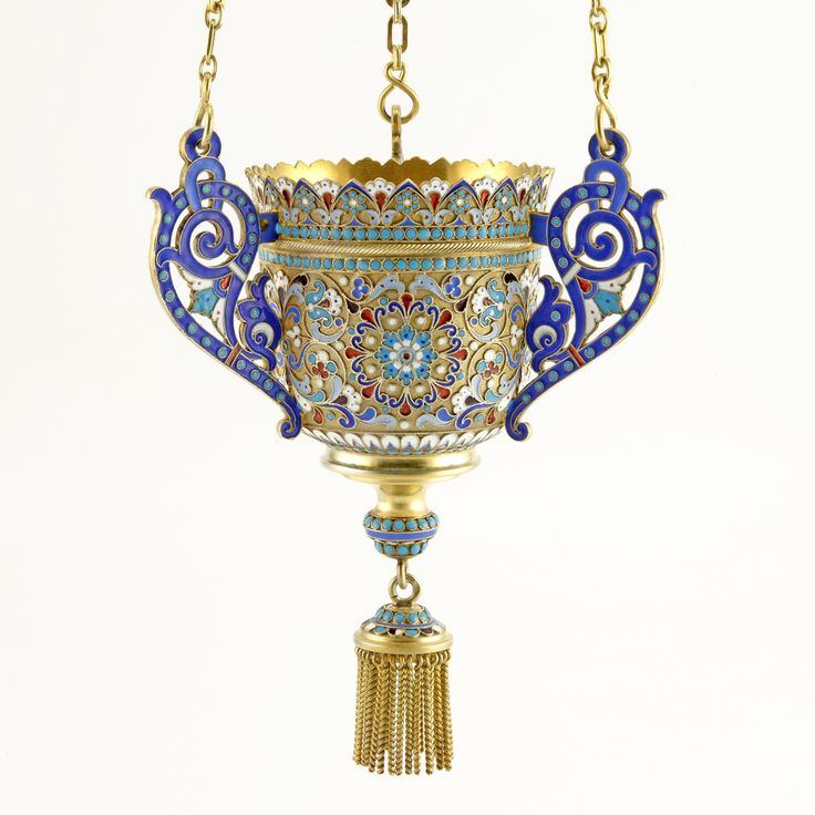 A Russian gilded silver and shaded and cloisonné enamel icon lamp, Moscow, circa 1898-1908. Colorfully enameled with foliate ornament, with scrolling handles, complete with canopy, suspension chains, and twisted cable tassel.