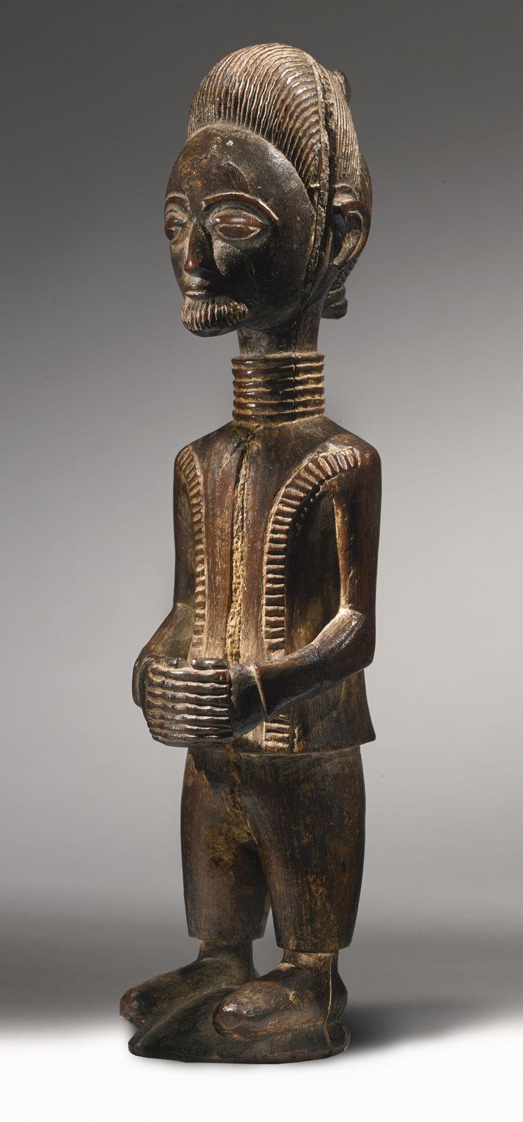 BAULE FIGURE, IVORY COAST Height: 9 5/8 in (24.4 cm) Estimate 6,000 — 9,000 USD