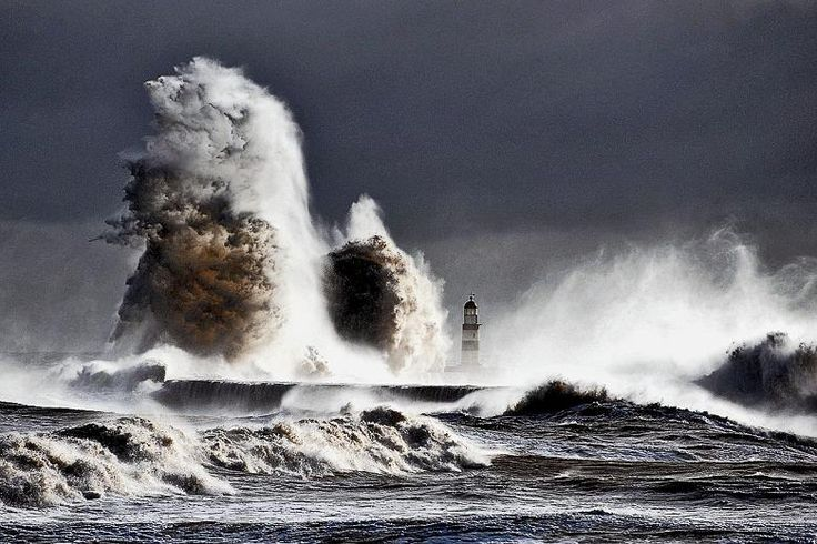 TheTimes  -    Waves crash at Seaham, Co Durham    February 7 2013 Owen Humphreys/PA  :Waves crashing on to the harbour at Seaham, Co Durham, broke yesterday to massive heights of well over 60ft, dwarfing the 33ft lighthouse.