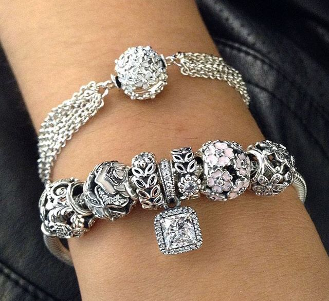 We love the sparkle and floral details on these #PANDORA bracelets.  Stacking one of