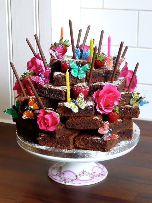 Louise's Kitchen ... & other rooms: A Stack of Chocolate Brownies with flowers and butterflies.  What a simple but beautiful idea, would be a great option to add some glamour to a cake sale.... Or for a birthday tea party!