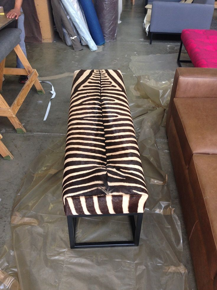 Zebra hide ottoman, made up in with powder coated base. www.whatnot.co.za