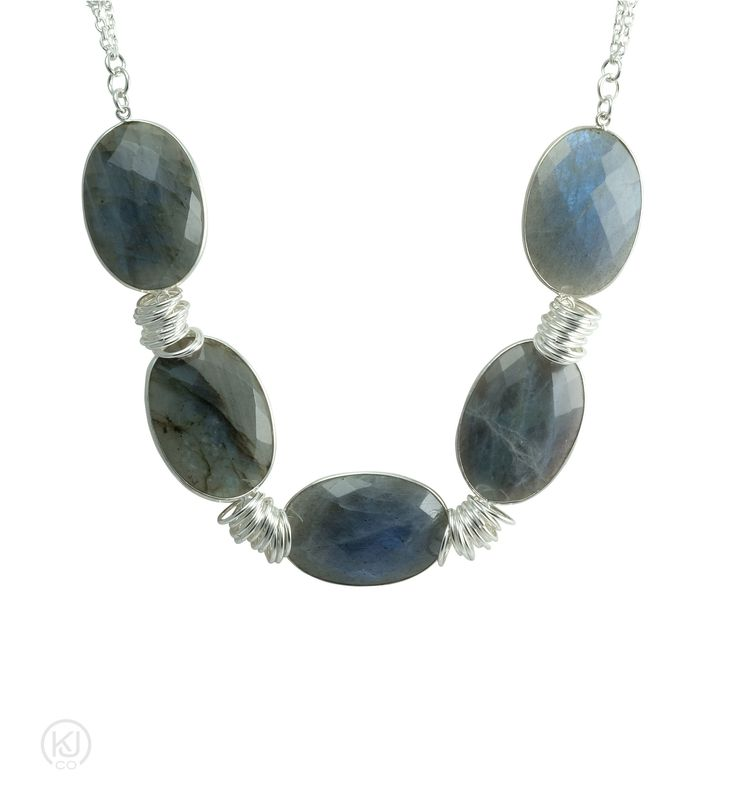 Gemma – Statement Necklace – No matter the gemstone you will be sure to make a statement with this big and bold large gemstone chunky necklace. Wear it on top of a collared blouse done all the way up or under the collar with a few buttons undone will take you from the office to a more casual evening out on the town. These beautifully handcrafted faceted bezel set gemstones, set in Rhodium plating on Sterling silver, with Sterling Silver ring accents, attached to a double Sterling Silver…