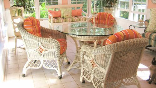 Custom wicker chair cushions in Sunbrella Dolce Mango fabric brighten up this sunroom with a hint of the tropics!