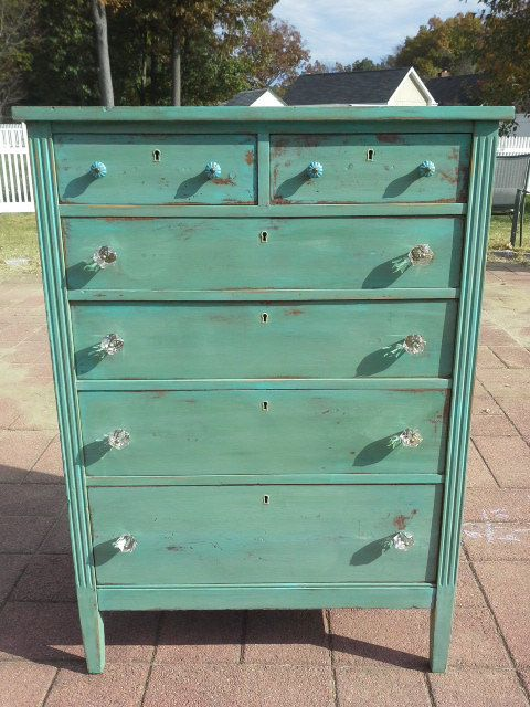 Green distressed tall dresser with teal turquoise highlights