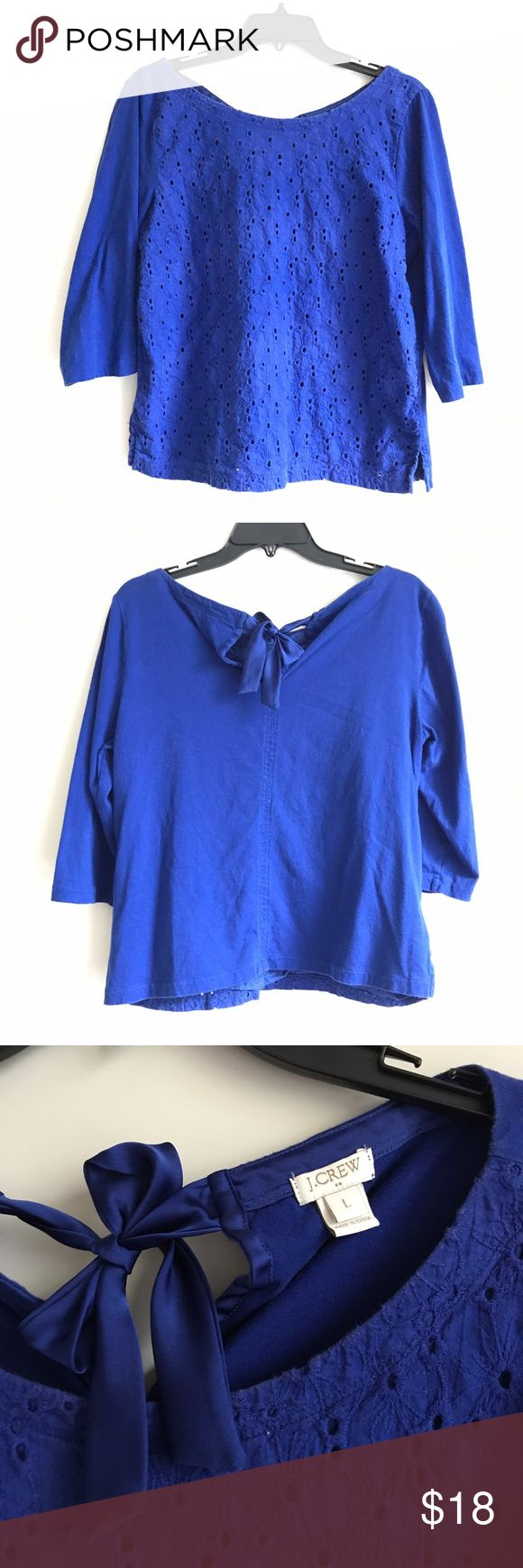 J. Crew royal blue eyelet shirt Royal blue three quarter length Blouse, with an eyelet design on the front. From Jcrew. Has a beautiful silk bow design in the back. Size large. J. Crew Tops Blouses