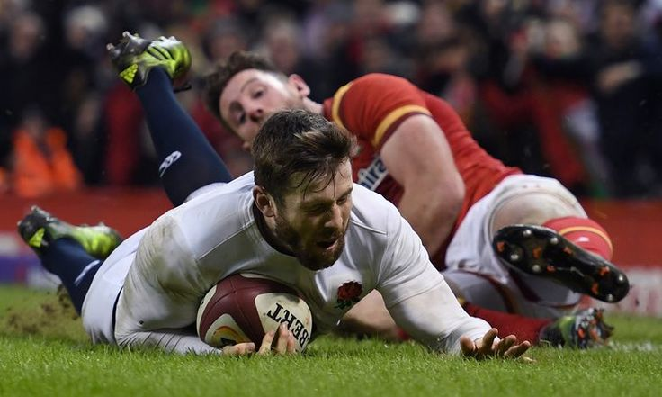 February 12 2017 - Elliot Daly of England dives past Alex Cuthbert of Wales to score the match winning try at the Six Nations in Cardiff