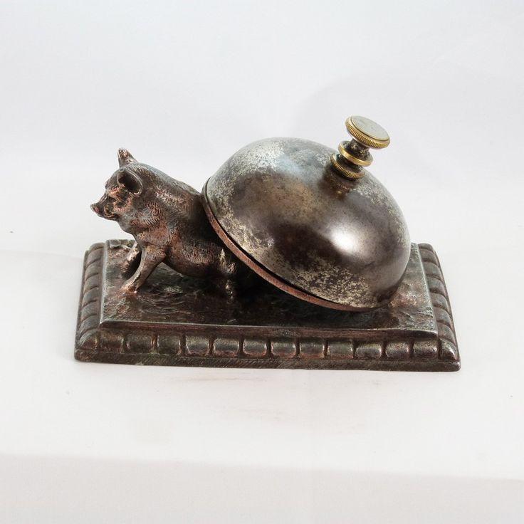 Campanello antico da tavolo con maiale.