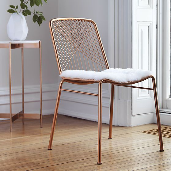 Coated in a warm copper finish, chair glamorously juxtaposes our wooden dining tables or adds shine to the home office.