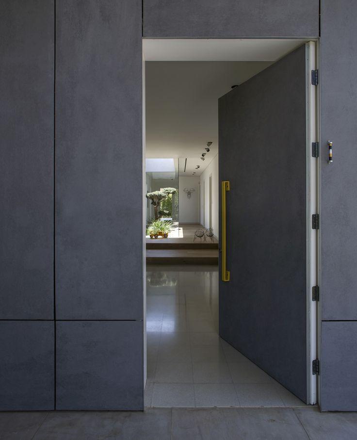 Door and facade integrated with same facade material. EQUITONE facade panels. equitone.com