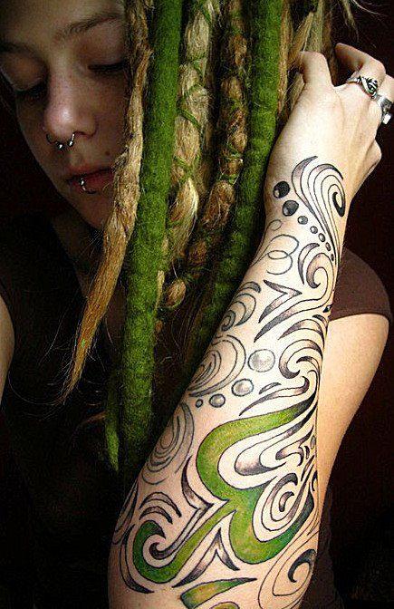 Green and blonde dreadlocks.