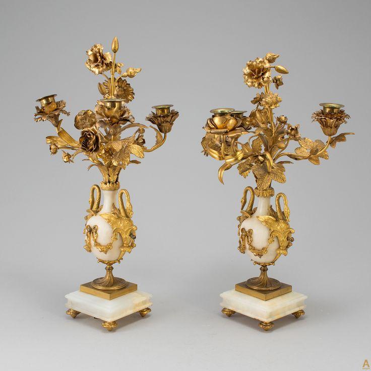 Пара подсвечников с агатом,богато украшенных элементами художественной ковки в виде цветов и листьев ,а так же ручками в виде лебедей.