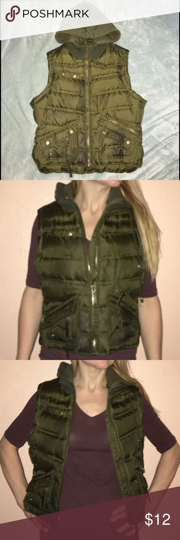 Down Feather Olive Green Hooded Vest No Boundaries, Down Feather Olive Green Hooded Vest in Great Condition! Ladies Size M. The Shell is 100% Polyester. The Lining is 95% Polyester & 35% Cotton. The Hood is 58% Cotton & 42% Polyester. The Filler is 60% Down & 40% Feathers. No Boundaries Jackets & Coats Vests