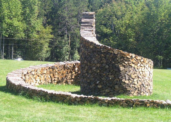 Cord wood spiral, Woodstock, Vermont by Ken Woodhead, 12 feet high at center. kenwoodart.com