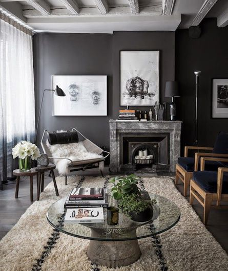cozy living room with raw woods, veiny marbles and sleek metals