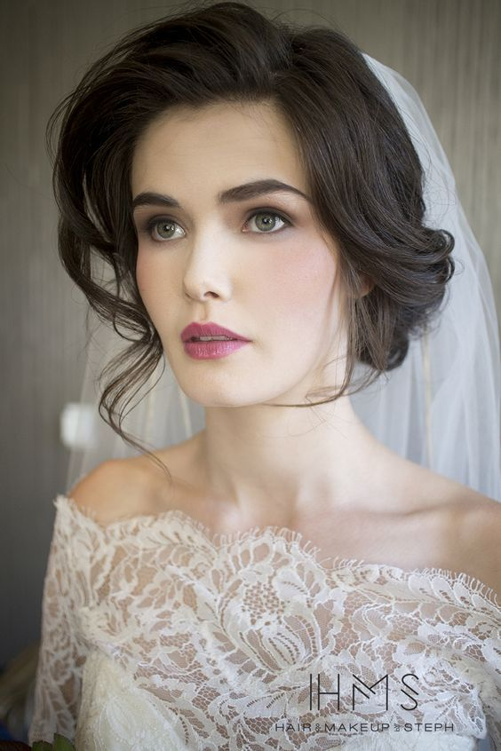 From foiled eyeshadow to bold red lips, these brides took glamour to the