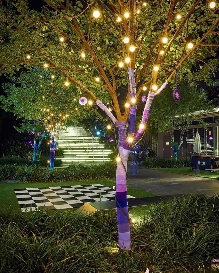 """queen_babs I was commissioned to warm up the @centralparkmall_ outdoor dining area in #Chippendale for winter and the Vivid Festival @vividsydney in #Sydney.  The """"Warm Woolly Winter Love"""" installation includes: 8 yarnbombed tree trunks decorated with 3 dozen #crocheted #lovebomb hearts 23 #knitted ribbon wrapped branches and 24 #crochet #mandalas on reflective mirrored circles hanging on a crocheted chain turning in the breeze and catching the light.  STATS There are over 80 different…"""