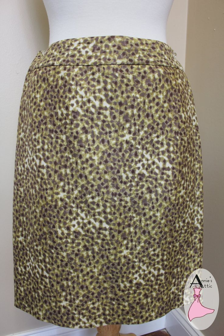 Ann Taylor LOFT skirt, size 0 Zips up the back with olive green ribbon 'trim' Back slit Animal print in olive, purple and white $25.50