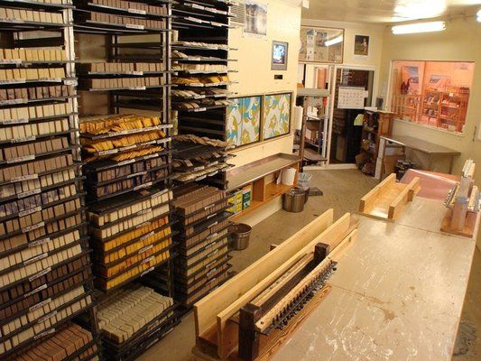 The natural soap making room, love the table, racks and labels. Need a sink.
