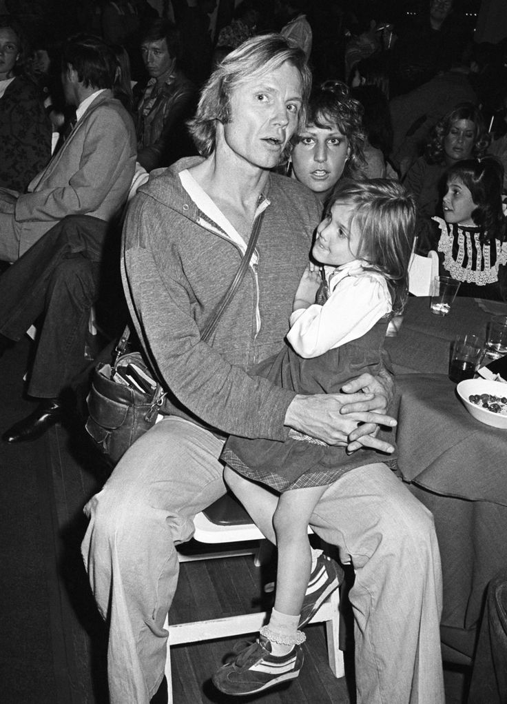 John Voight with little Angelina Jolie at a party for Blondie Fiorucci, 1978. Photo by Photo by Brad Elterman.