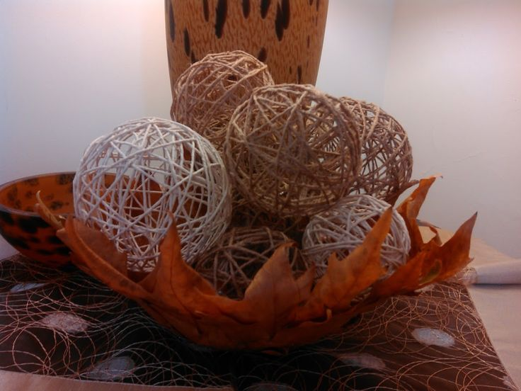 with leaves of plane tree and  jute yarn balls .