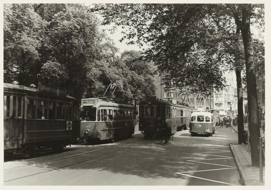 1950's. A view of the Raadhuisstraat in Amsterdam. On the right a KLM passenger bus. The Raadhuisstraat is a street in the center of Amsterdam located between Nieuwezijds Voorburgwal and Prinsengracht. The street was named after the former city hall on the Dam Square, now the Royal Palace. The Raadhuisstraat was built in 1895. Photo Jeroen Epema. #amsterdam #1950 #Raadhuisstraat