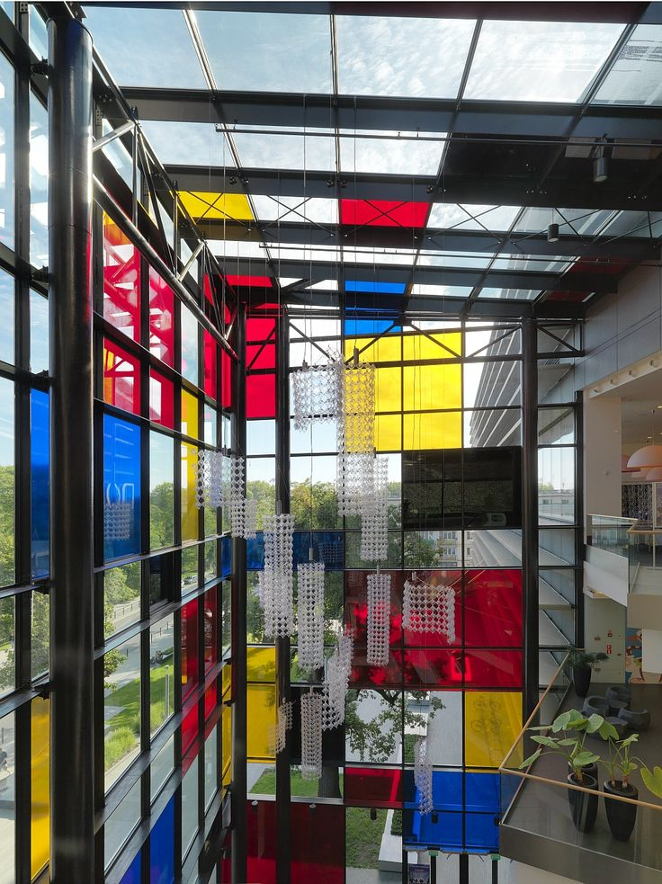 Renoma in Wrocław, Poland - the entrance glass facade decorated with vertical and horizontal rectangles in primary colours designed by Maurycy Gomulicki.