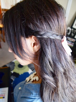 ::2 simple braids on each side that connect in the back with a Big Bold Bow!  Fun hairstyle to change it up and it only takes 5 mins! Loose beach waves were curled with my paul mitchell flat iron and bow was purchased at Soel botique.