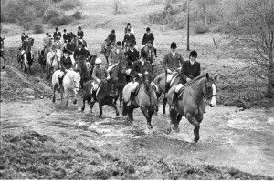 Members of the Haydon Hunt cross a swollen stream at Newbiggin as they take part in their first meet of the New Year. The hunt had earlier met at Dipton Mill, Hexham. (Edition: January 3, 1986).