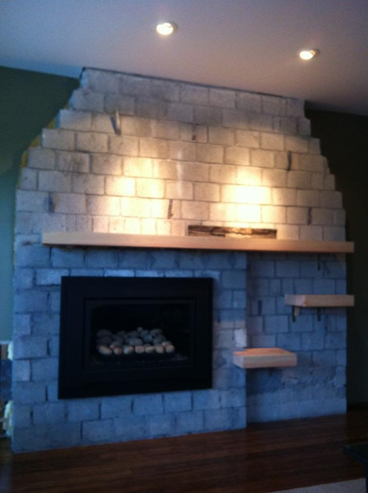 So here's what we did; a mantel, and two small shelves to balance the fireplace.