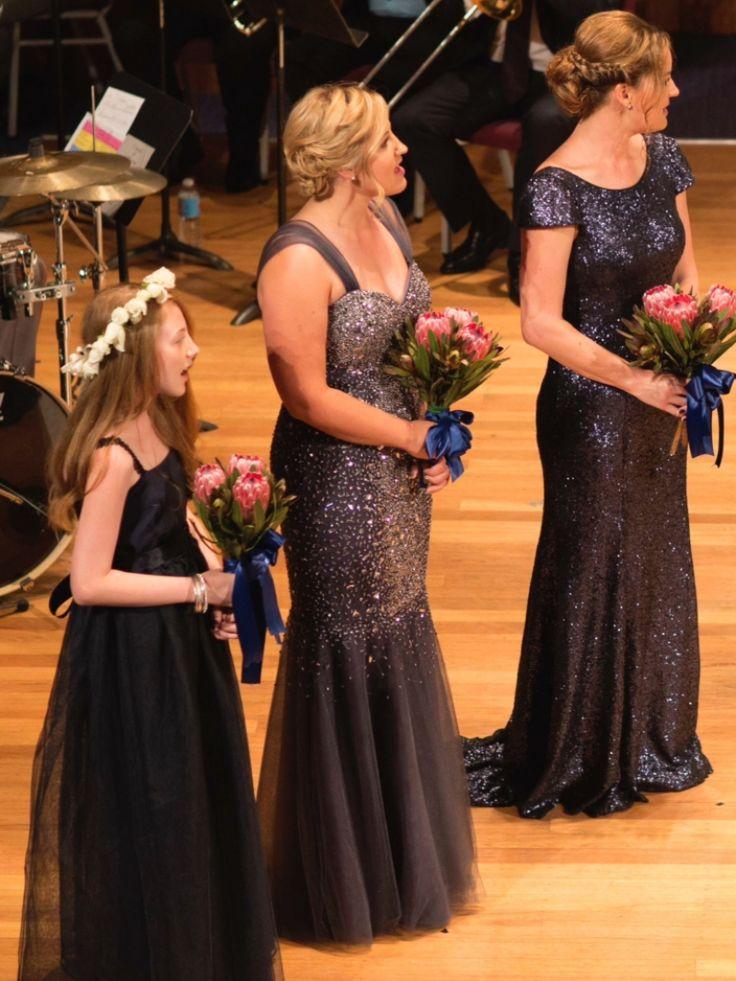 Mismatched navy bridesmaids dresses, pink ice protea bouquet, wedding ceremony
