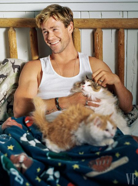That's one Lucky Cat...MEEEOOOWW    Chris Hemsworth and some furry friends. Photograph by Bruce Weber.