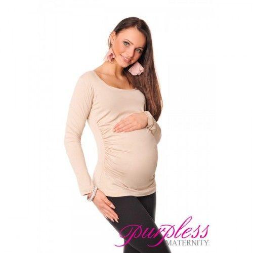 Velmi elastický a měkký materiál sedí každé postavě. Dlouhé rukávy Nabírání na obou stranách vytváří spoustu místa pro rostoucí bříško Funkční a pohodlné, může být nošeno během těhotenství i po porodu Doporučujeme nosit pod svetr nebo kabát nebo v kombinaci s legínami Délka  Délka je závislá na velikosti bříška, mezi 56-64cm Délka rukávů je závislá na velikosti, mezi 56-62cm Látka  Viskóza 95%, Elasten 5%