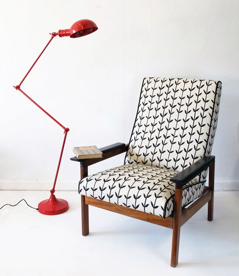 Red standing task lamp and skinny laminx (i think)  fabric on mid century modern chair is awesome.