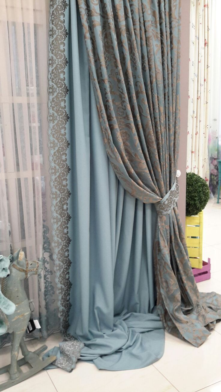 Pretty leading edge triple layered window treatment: sheers, leading edge accent panel, and final damask pattern heavy over panel pulled back