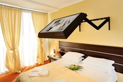 THIS IS COOOL - picture pulls out for hidden tv ... not that I want one in the bedroom but still awesome