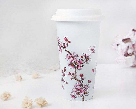 Here is an eco-friendly alternative to sipping (ice)coffee or tea on the go!    The design is a wrap-around cherry blossoms. The colors are delicate