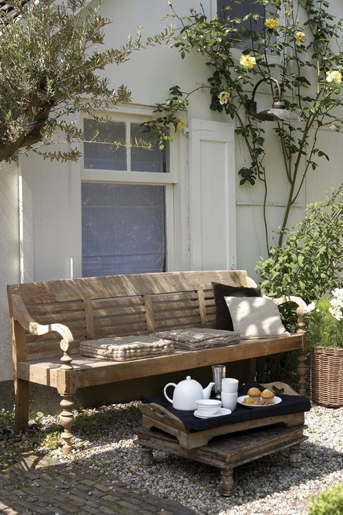 Teak garden bench , a low table surface, wooden tray. Beautifully basic