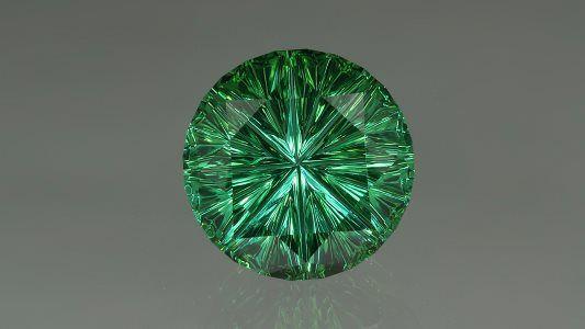 """Если бы звезды пылали зеленым огнем, то они могли бы выглядеть также как зеленый турмалин фантазийной огранки """"Звездное пламя"""" весом 14,56 карата, созданный Джоном Дайером."""