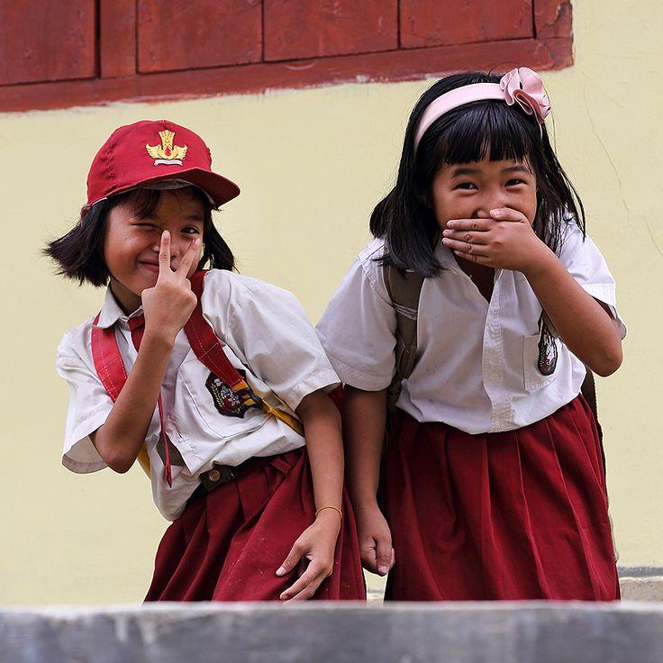 Hello Mister! Kids on Nias Island, Indonesia joking around with tourists. Photo by Bjorn Svensson