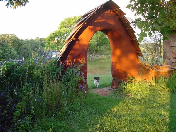 garden arch made of cobb straw clay and sand
