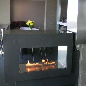 Two stunning views from anywhere you desire. An airy, open-window feel is the highlight of this unique Ventless Gas Fireplace design. Sleek, contemporary dual facades blend seamlessly into the environment to subtly define open space, while the ventless installation provides for the ultimate flexibility.