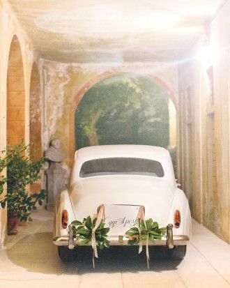 """A vintage Silver Cloud Rolls-Royce, bearing a """"married today!"""" sign in Italian, made for a romantic getaway back to the Villa d'Este, where John and Chrissy stayed."""
