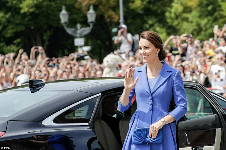 Kate waves to the crowds after exiting her car to meet members of the public gathered at the Pariser Platz