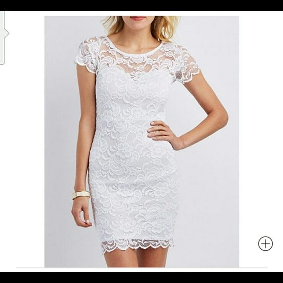 New beautiful lace white dress New with tags. Beautiful white lace dress. Charlotte Russe Dresses Mini