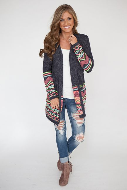 Shop our Neon Tribal Sweater Cardigan. Navy long sleeve cardigan featuring neon aztec print! Free shipping on all US orders.