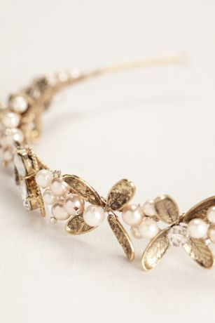 This unique leaf headband is a perfect way to dress your hair up for any occasion! Gold leaf headband is adorned with milky and clear stones and pink pearls. Available in Gold. Imported.